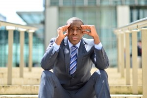 """Depressed Businessman Sitting At Outdoors"""" by stockimages"""